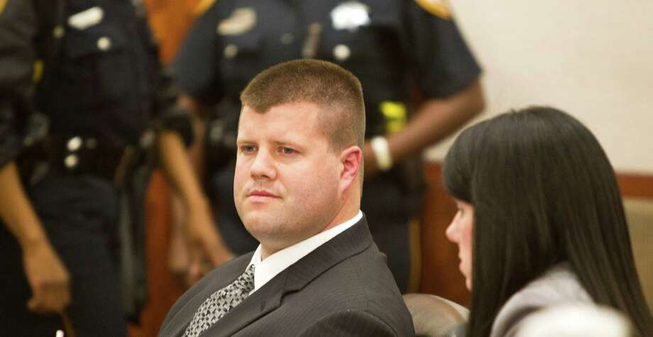 Ex_Houston Police Department officer Drew Ryser, left, looks around as he sits with his attorney Lisa Andrews after Judge Ruben Guerrero read the guilty verdict for official oppression, Wednesday, June 12, 2013, in the Harris County Criminal Justice Center in Houston. Ryser is the fourth HPD officer involved in the 2010 videotaped beating of then 15-year old Chad Holley. ( Nick de la Torre / Houston Chronicle ) Photo: Nick De La Torre, Staff / © 2013  Houston Chronicle