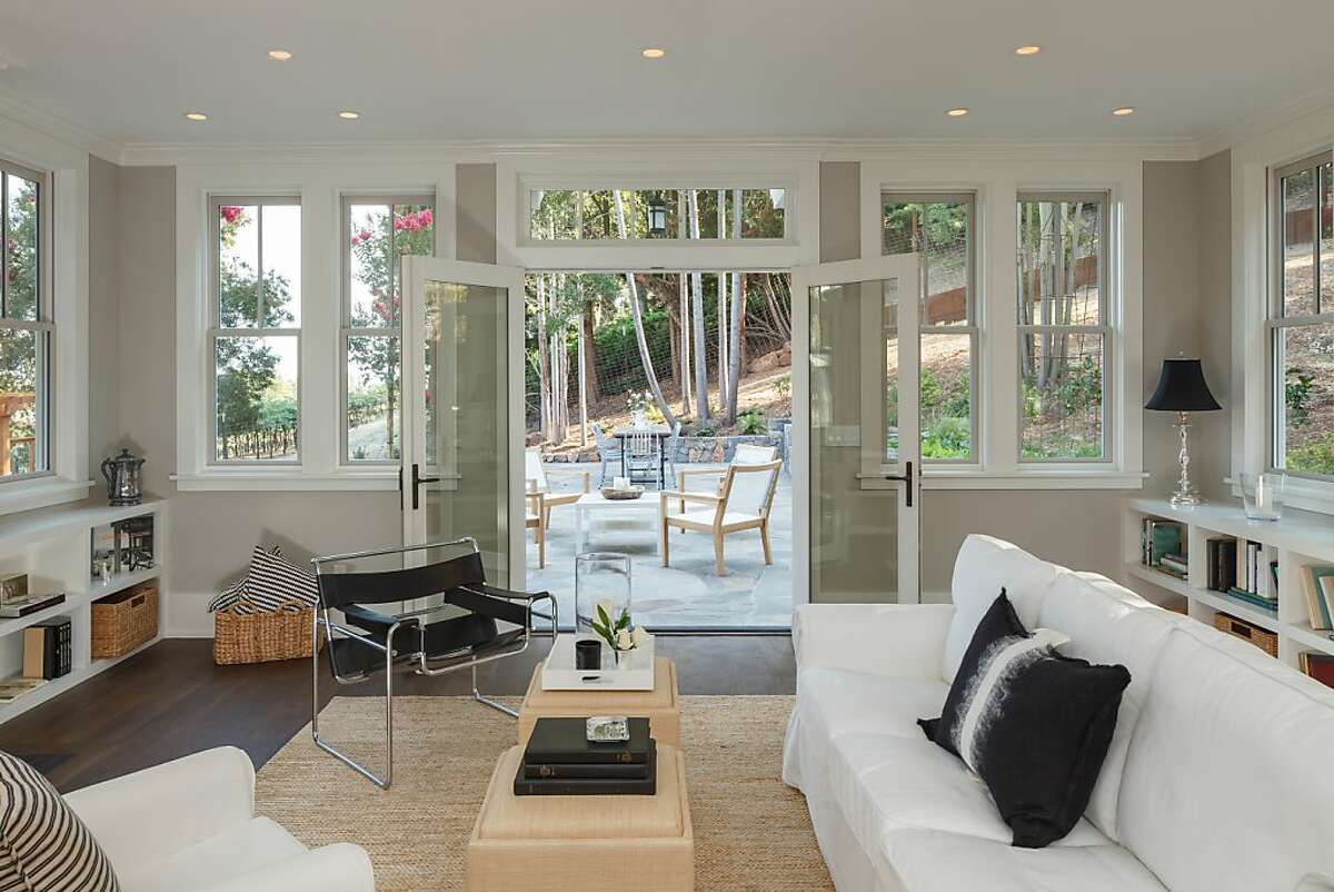 The family room opens to the stone patio in the backyard through French doors.