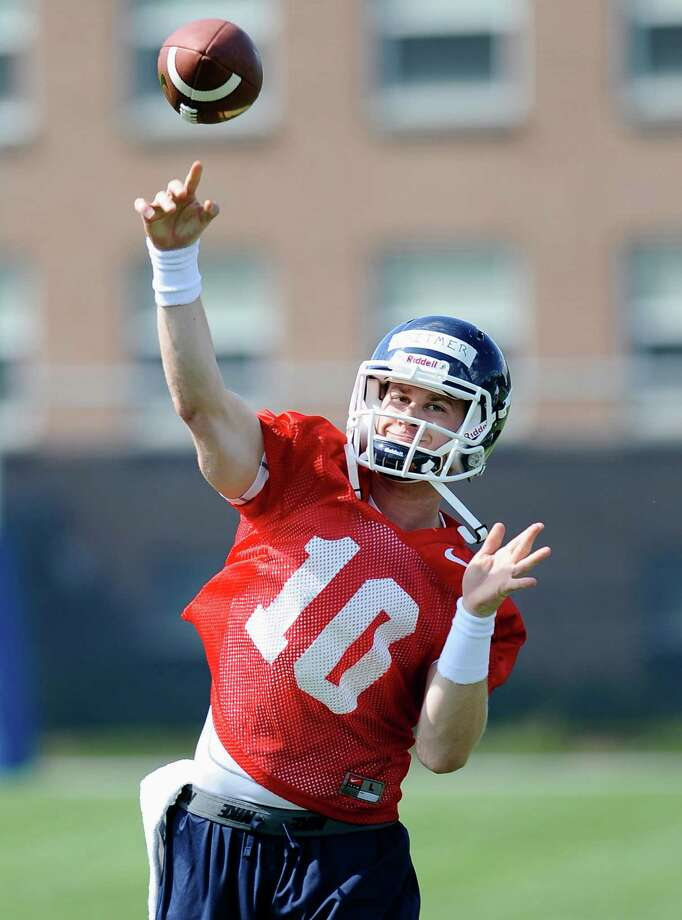 Connecticut quarterback Chandler Whitmer throws during NCAA college football practice in Storrs, Conn., Friday, Aug. 2, 2013. (AP Photo/Jessica Hill) Photo: Jessica Hill, Associated Press / Associated Press