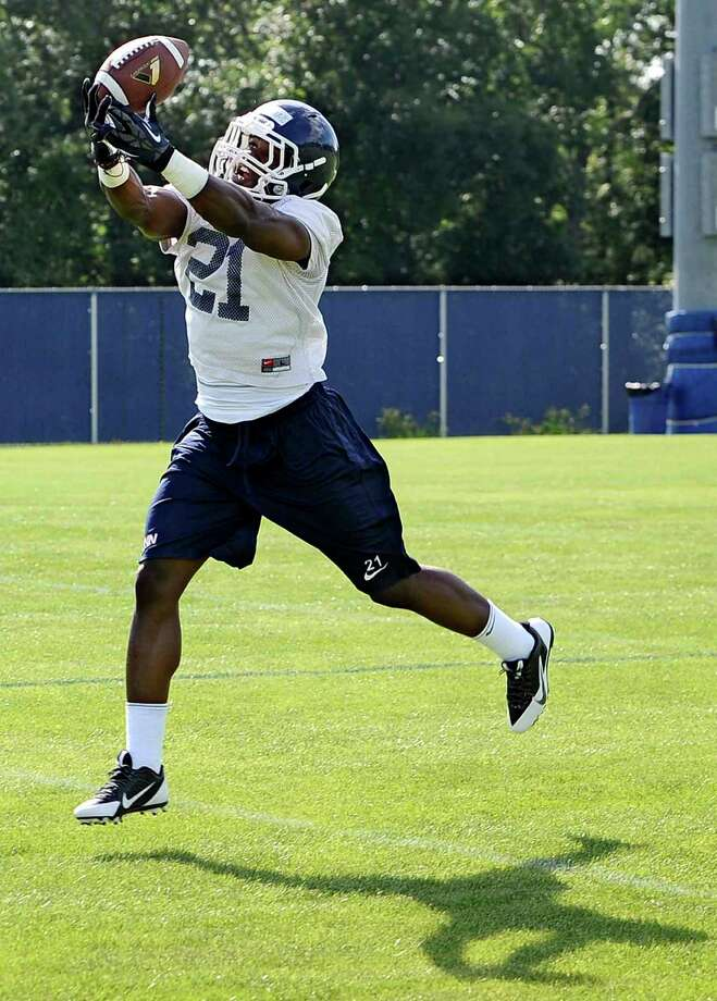 Connecticut tailback Joseph Williams makes a catch during NCAA college football practice in Storrs, Conn., Friday, Aug. 2, 2013. (AP Photo/Jessica Hill) Photo: Jessica Hill, Associated Press / Associated Press