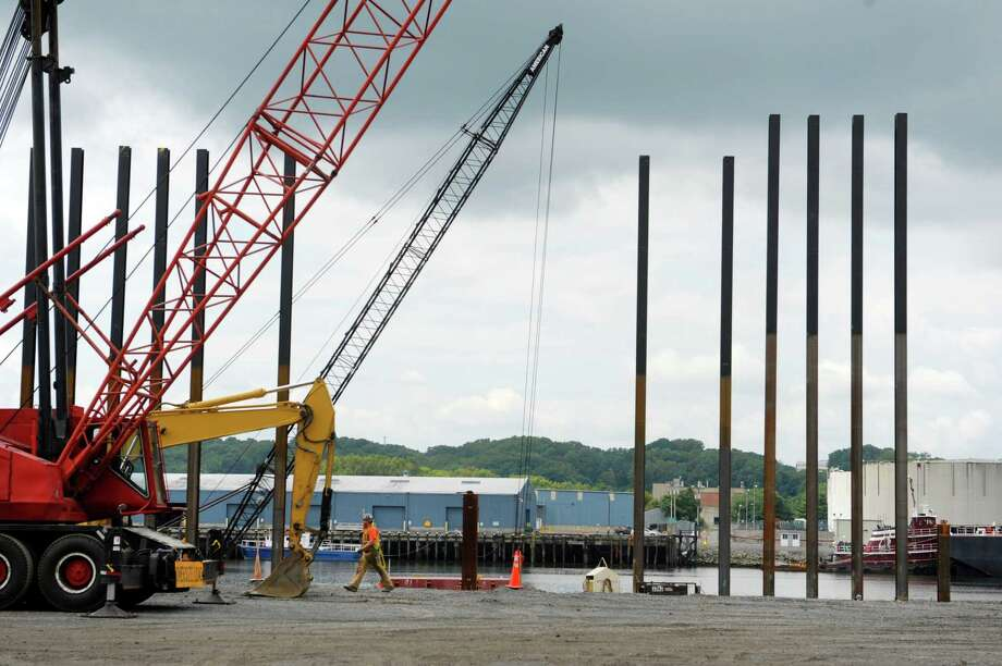 H-Piles, structural beams that will be driven into the ground, are seen as workers with D.A. Collins Companies construct a new wharf on the Rensselaer side of the Port of Albany Tuesday, Aug. 27, 2013, in Rensselaer, N.Y.  In the background is the Albany side of the port.  (Paul Buckowski / Times Union) Photo: Paul Buckowski / 00023651A