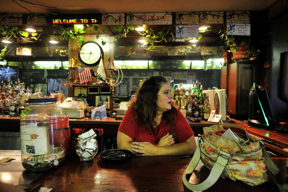 Sheila Bogacz tends the bar at the Fraternal Order of Eagles club in Stamford on Tuesday, Aug. 27, 2013. Photo: Jason Rearick / Stamford Advocate