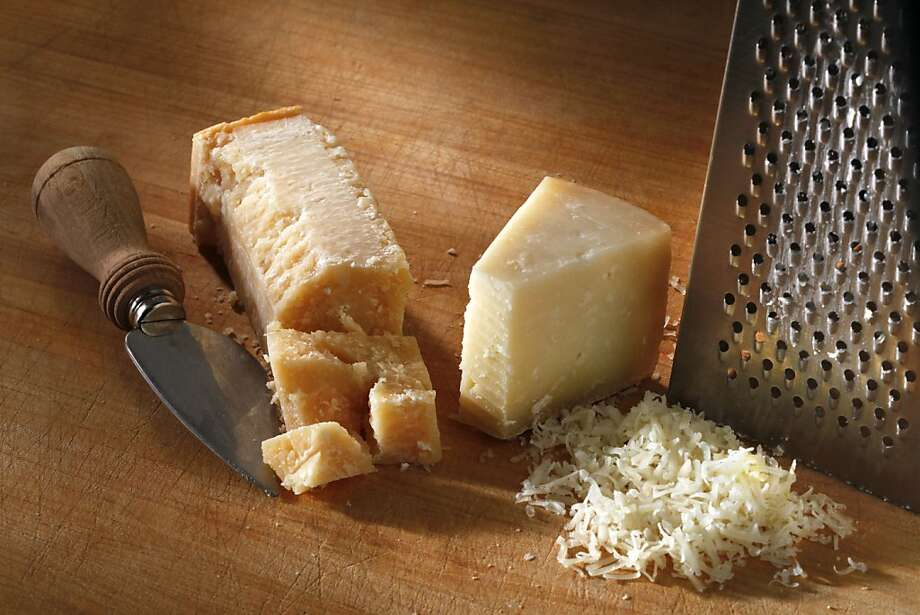 Parmigiano-Reggiano (left) and Pecorino Romano can both be grated, but pecorino Romano brings a salty tang to summer vegetables. Photo: Craig Lee, Special To The Chronicle