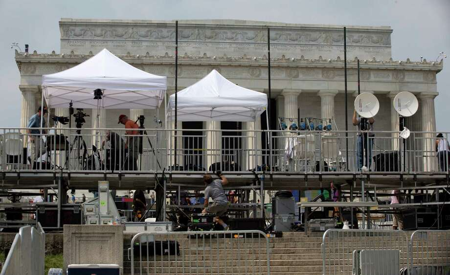 "Members of the media set up equipment in front of the Lincoln Memorial in Washington, Tuesday, Aug. 27, 2013, for the 50th anniversary of the March On Washington celebrations that will be held Wednesday, Aug, 28, 2013.  Barack Obama, who will speak, was 2 years old and growing up in Hawaii when Martin Luther King Jr. delivered his ""I Have a Dream"" speech from the steps of the Lincoln Memorial. Fifty years later, the nation's first black president will stand as the most high-profile example of the racial progress King espoused, delivering remarks at a nationwide commemoration of the 1963 demonstration for jobs, economic justice and racial equality.   (AP Photo/Carolyn Kaster) ORG XMIT: DCCK108 Photo: Carolyn Kaster / AP"