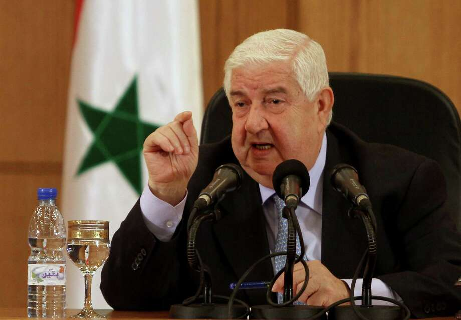 "Syrian Foreign Minister Walid al-Moallem speaks during a press conference in Damascus, Syria on Tuesday, August 27, 2013. Syria's foreign minister said Tuesday his country would defend itself using ""all means available"" in case of a U.S. strike, denying his government was behind an alleged chemical weapons attack near Damascus and challenging Washington to present proof backing up its accusations.(AP Photo) ORG XMIT: CAI106 Photo: Uncredited / AP"