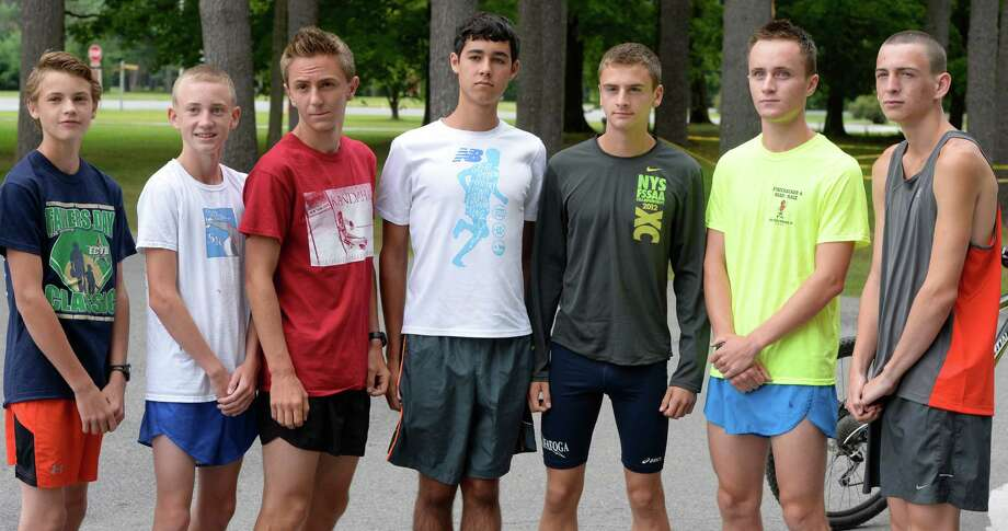 Members of Saratoga High School Cross Country Team from left; Will Messier, Aidan Tooker, Joe Verro, Jay Navin, Chris Edwards, Brent Freestone and Ethan North before practice at the Saratoga Spa State Park Monday morning, Aug 26, 2013, at Saratoga Spa State Park in Saratoga Springs, N.Y.  (Skip Dickstein/Times Union) Photo: SKIP DICKSTEIN
