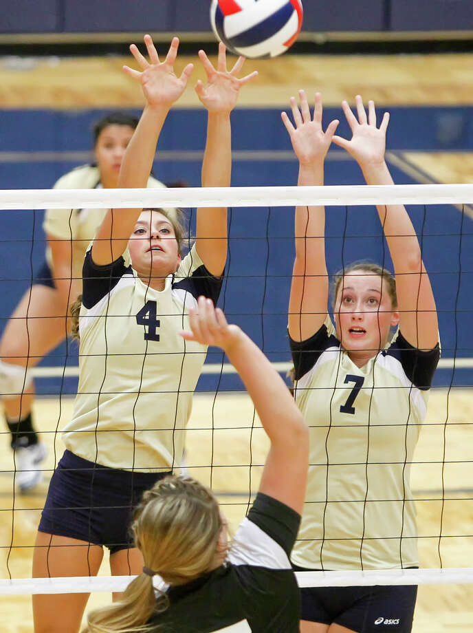 "O'Connor's McKenzie Kelley (left) and Laura Fox leap to try to block a shot by Clark's Megan Pattison during their District 27-5A volleyball match at Paul Taylor Field House on Tuesday, Aug. 27, 2013. O""Connor won the match in three straight sets:  25-23, 25-15 and 25-19.  MARVIN PFEIFFER/ mpfeiffer@express-news.net Photo: MARVIN PFEIFFER, Marvin Pfeiffer/ Express-News / Express-News 2013"
