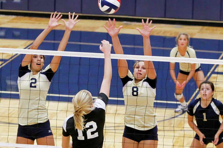 O'Connor's Alex Ecker (left) and Gillianne Simpkins try to block a shot by Clark's Kim Gillette as Laura Cruz (right) and Emily Starnes look onduring their District 27-51 volleyball match at Paul Taylor Field House on Tuesday, Aug. 27, 2013. O'Connor won the match in three straight sets:  25-23, 25-15 and 25-19.  MARVIN PFEIFFER/ mpfeiffer@express-news.net Photo: MARVIN PFEIFFER, Marvin Pfeiffer/ Express-News / Express-News 2013