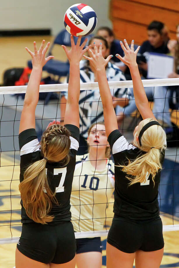 Clark's Megan Pattison (left) and Kristin Moczygemba leap to try to block a shot by O'Connor's Anna Faryniarz during their District 27-51 volleyball match at Paul Taylor Field House on Tuesday, Aug. 27, 2013. O'Connor won the match in three straight sets:  25-23, 25-15 and 25-19.  MARVIN PFEIFFER/ mpfeiffer@express-news.net Photo: MARVIN PFEIFFER, Marvin Pfeiffer/ Express-News / Express-News 2013