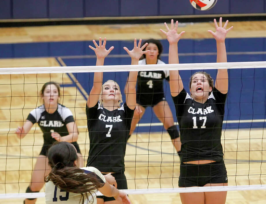Clark's Megan Pattison (right) and Kristin Moczygemba try to block a shot by O'Connor's Brianna Sotello (below) during their District 27-5A volleyball match at Paul Taylor Field House on Tuesday, Aug. 27, 2013. O'Connor won the match in three straight sets:  25-23, 25-15 and 25-19.  MARVIN PFEIFFER/ mpfeiffer@express-news.net Photo: MARVIN PFEIFFER, Marvin Pfeiffer/ Express-News / Express-News 2013