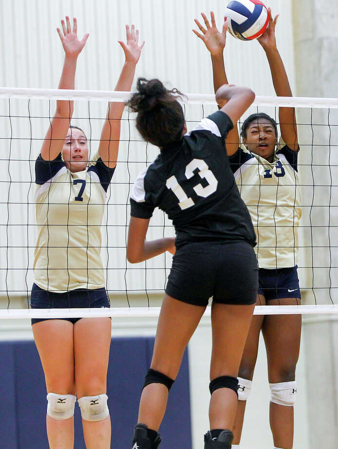 O'Connor's Jordn Williams (right) blocks a shot by Clark's Gabby Ware as Laura Fox goes up to help during their District 27-5A volleyball match at Paul Taylor Field House on Tuesday, Aug. 27, 2013. O'Connor won the match in three straight sets:  25-23, 25-15 and 25-19.  MARVIN PFEIFFER/ mpfeiffer@express-news.net Photo: MARVIN PFEIFFER, Marvin Pfeiffer/ Express-News / Express-News 2013