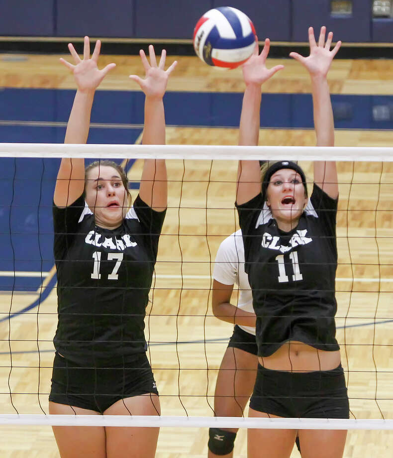 Clark's Megan Pattison (left) and Katie Mattson try to block a shot during their District 27-5A volleyball match with O'Connor at Paul Taylor Field House on Tuesday, Aug. 27, 2013. O'Connor won the match in three straight sets:  25-23, 25-15 and 25-19.  MARVIN PFEIFFER/ mpfeiffer@express-news.net Photo: MARVIN PFEIFFER, Marvin Pfeiffer/ Express-News / Express-News 2013