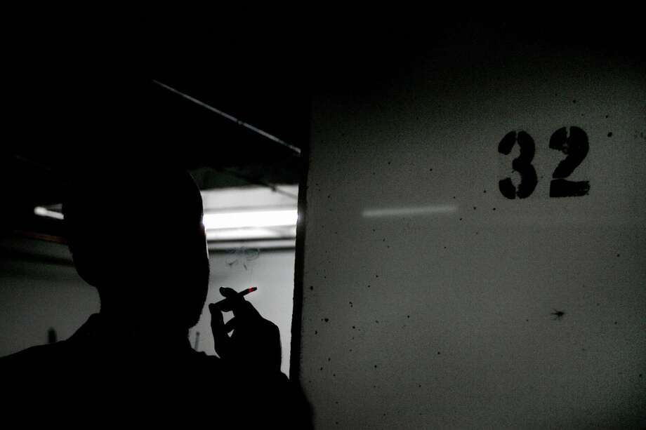 "A reporter smokes a cigarette beside Column 32 on the D floor of the garage at 1401 Wilson Blvd 01 July 2005 in Rosslyn, VA, where Washington Post reporter Bob Woodward had his clandestine meetings with former FBI official Mark Felt, otherwise know as ""Deep Throat"", the secret source in the Watergate scandal that brought down the presidency of Richard M. Nixon in 1974. Photo: JIM WATSON, AFP/Getty Images"