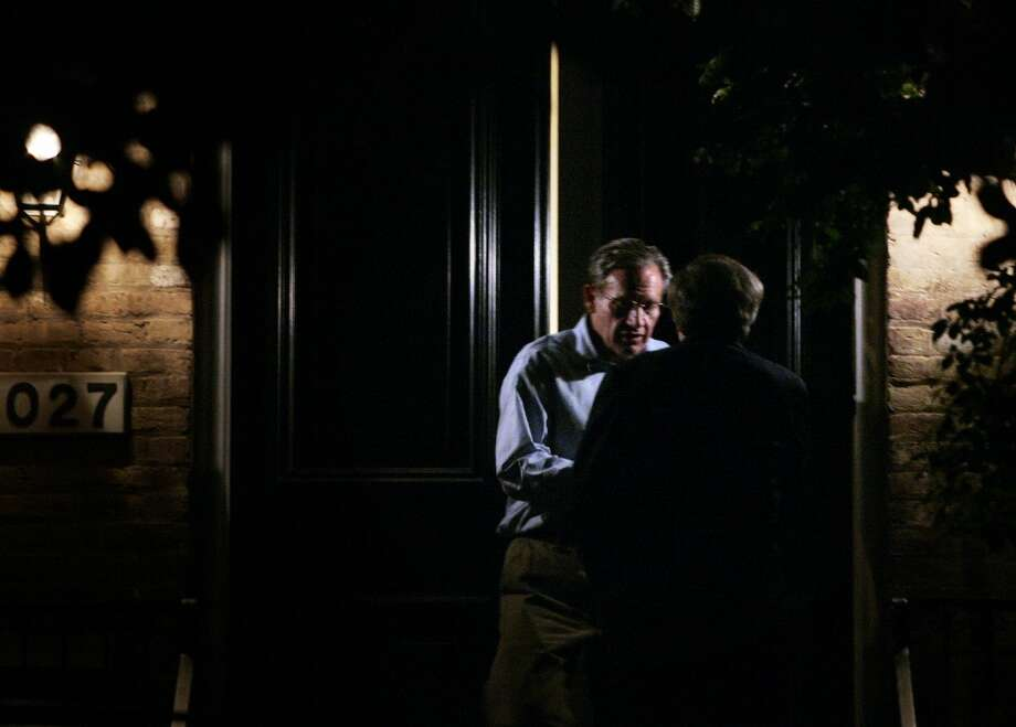 """Former Washington Post reporter Bob Woodward meets with an unidentified person at Woodward's home May 31, 2005 in Washington, DC. Woodward, along with former Post reporter Carl Bernstein, helped link a break-in at the Watergate Hotel in 1972 to the White House, with the help of former FBI Deputy Director W. Mark Felt, dubbed """"Deep Throat"""" by a Post editor. Woodward and Bernstein confirmed today that Felt was indeed the source for their stories that ultimately led to the resignation of President Nixon in 1974. Photo: Brendan Smialowski, Getty Images"""