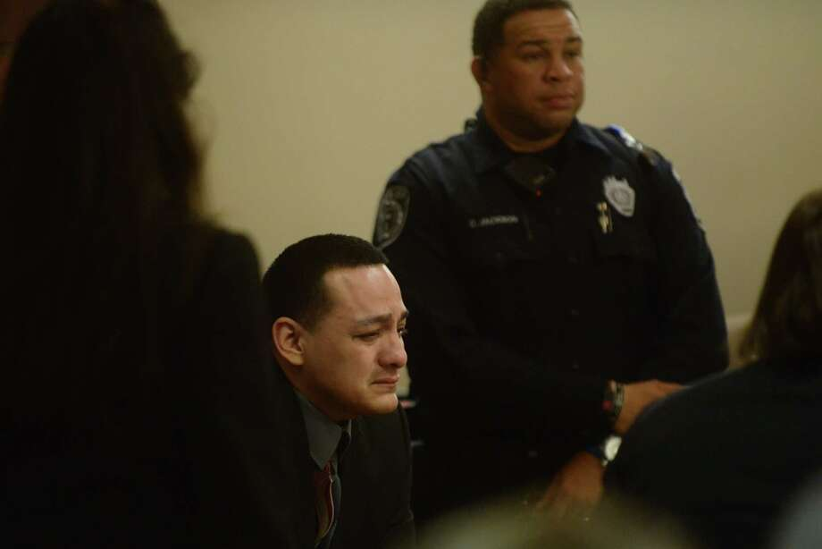 Defendant Juan Robles weeps Tuesday after being found not guilty of capital attempted murder. He was accused of robbing a man and setting him on fire with gasoline. Five eyewitnesses were the victim's original attackers. Photo: Billy Calzada /