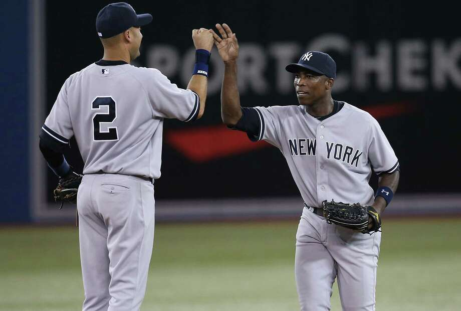 Derek Jeter (2), who knows something about milestones, celebrates the Yankees' win with Alfonso Soriano, whose two home runs gave him 400 for in his career. Photo: Tom Szczerbowski, Stringer / 2013 Getty Images