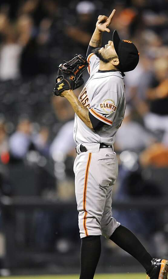 Sergio Romo celebrates closing out the Giants' victory over the Rockies. Photo: Jack Dempsey, Associated Press