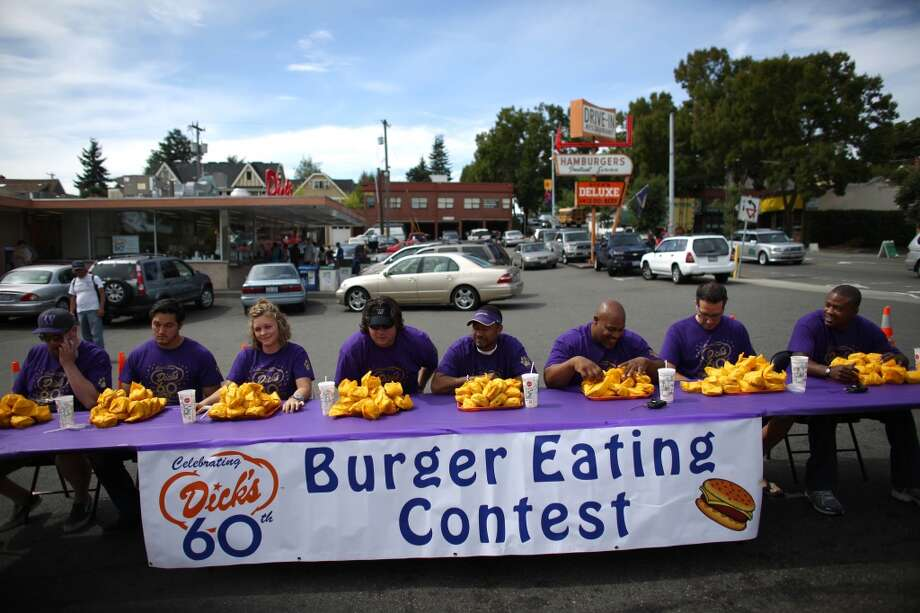 Contestants wait for the start during a cheeseburger eating contest at Dick's Drive-In on 45th Street in Wallingford. The contest pitted legendary Husky football players and fans of the restaurant against each other as they devoured cheeseburgers. Photo: JOSHUA TRUJILLO, SEATTLEPI.COM