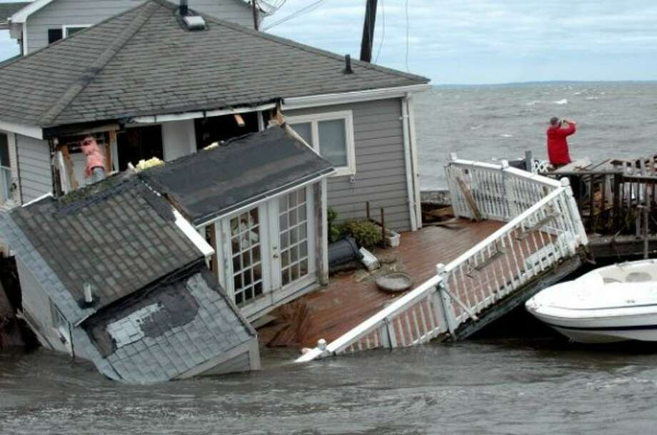 A home on Fairfield Beach Road is submerged in Pine Creek in Fairfield, Conn., as treacherous weather caused by Tropical Storm Irene blew through the area on Sunday, Aug. 28, 2011.