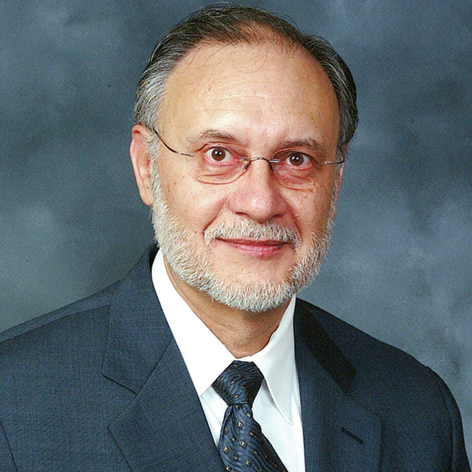 Dr. C. Enrique Batres is a dermatologist who practices at Kelsey-Seybold-Sugar Land. Photo: Contributed