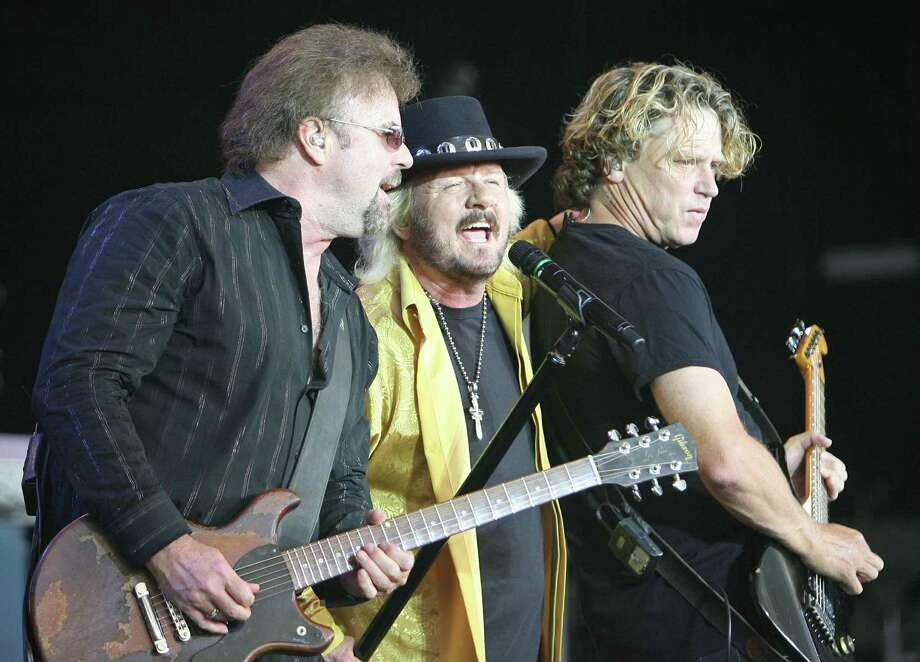 "38 Special band members, from left,  Don Barnes, Donnie Van Zant and Danny Chauncey  perform Sunday,June 7, 2009 at the Cynthia Woods Mitchell Pavilion in The Woodlands, Texas. The band opened for REO Speedwagon and Styx on their ""Can't Stop Rockin"" tour stop. (AP Photo/The Courier, Eric S. Swist) Photo: Eric S. Swist / The Courier"