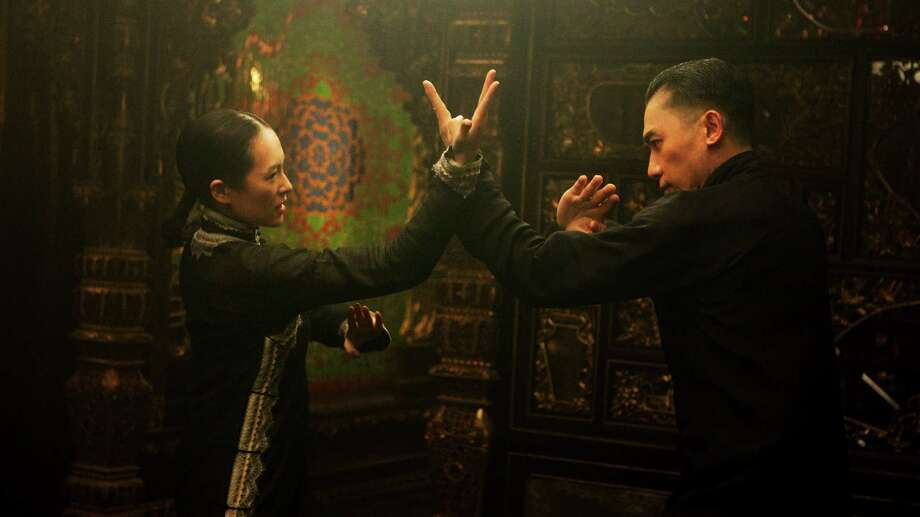 "This publicity photo released by courtesy of The Weinstein Company shows Ziyi Zhang, left, and Tony Leung Chiu Wai, in The Weinstein Company's upcoming release, ""The Grandmaster."" Wong Kar Wai swears he's seen people fly. The acclaimed Hong Kong director crossed China meeting 100 kung fu masters as research for his new film about Bruce Lee's teacher, ""The Grandmaster."" (AP Photo/Courtesy The Weinstein Company) ORG XMIT: CAPH423 / Cortesy Weinstein Company"