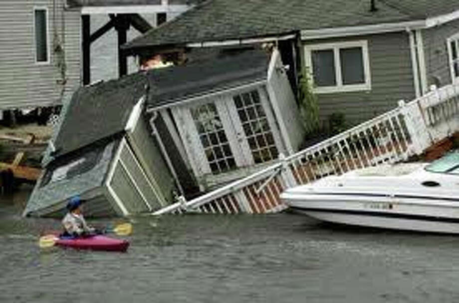 Tropical Storm Irene would leave many in the dark for days but her devastation paled in comparison to Superstorm Sandy a year later. Photo: File Photo / Fairfield Citizen