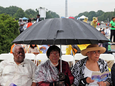 Stanley Samuels and Rita Samuels, from Atlanta, Ga., left, and Sammie Whiting-Ellis, from Washington, D.C., who attended the March on Washington 50 years ago where Martin Luther King, Jr., spoke, wait for the anniversary program to begin in front of the Lincoln Memorial in Washington, Wednesday, Aug. 28, 2013. Photo: Charles Dharapak, AP / AP
