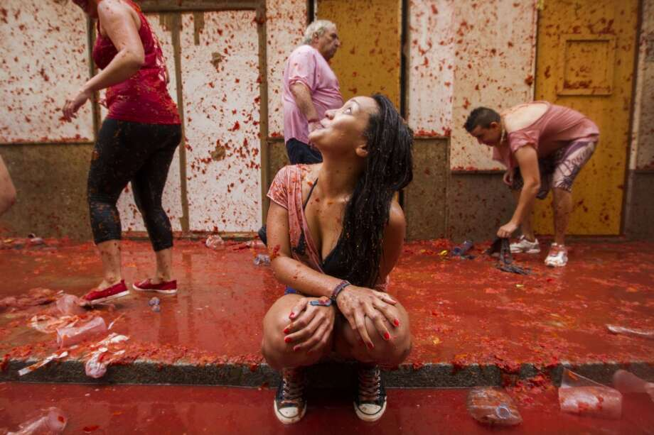 "Revellers take part in the annual ""Tomatina"" festivities in Bunol, near Valencia. Photo: Gabriel Gallo, AFP/Getty Images"