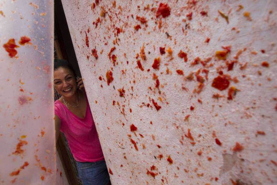 "A reveller phones as she takes part in the annual ""Tomatina"" festivities in Bunol. Photo: Gabriel Gallo, AFP/Getty Images"