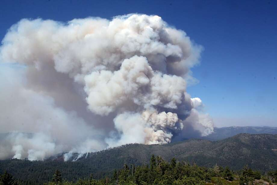This photo obtained August 28, 2013 courtesy of the US Forest Service, shows a view from Pilot Peak lookout of the Rim Fire .  The wildfire threatening Yosemite National Park is still burning its way into the huge US tourist attraction despite dogged efforts by thousands of firefighters using planes and bulldozers. Ash is gathering on the surface of a reservoir serving San Francisco, but officials said water quality has not been affected. The so-called Rim Fire -- California's seventh biggest ever -- now covers some 281 square miles ,  an area bigger than Chicago. The fire, which broke out August 17,  was still only 20 percent contained compared to 15 percent on August 26, 2013.  Highway 120, a main road into Yosemite from the west, remains closed as more than 3,700 firefighters battle the flames.  Photo: Mike Mcmillan, AFP/Getty Images