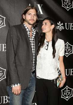 Demi Moore has famously been linked to Ashton Kutcher and Bruce Willis. Photo: Jim Spellman, WireImage