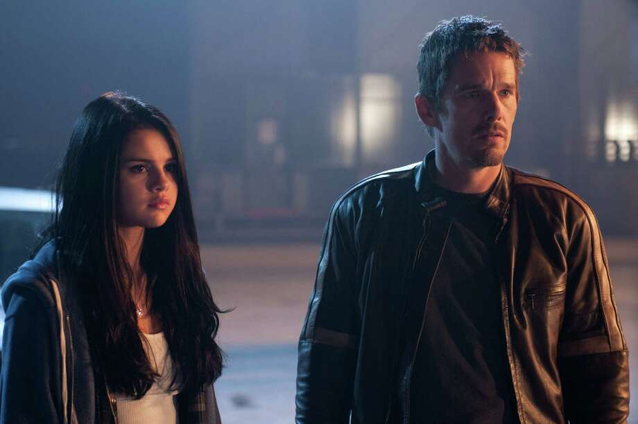 "This film image released by Warner Bros. Pictures shows Selena Gomez, left, and Ethan Hawke in a scene from ""Getaway."" Photo: Simon Varsano, Associated Press / Warner Bros. Pictures"