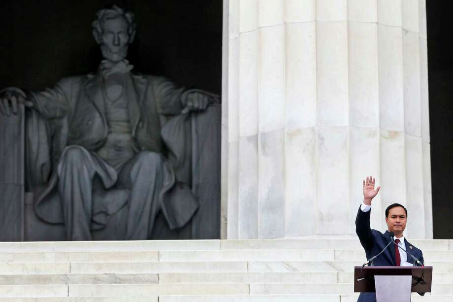 Rep. Joaquin Castro, D-Texas waves as he speaks at the 50th Anniversary of the March on Washington where Martin Luther King, Jr., spoke, Wednesday, Aug. 28, 2013, in front of the Lincoln Memorial in Washington. (AP Photo/Charles Dharapak) Photo: Charles Dharapak, Associated Press / AP