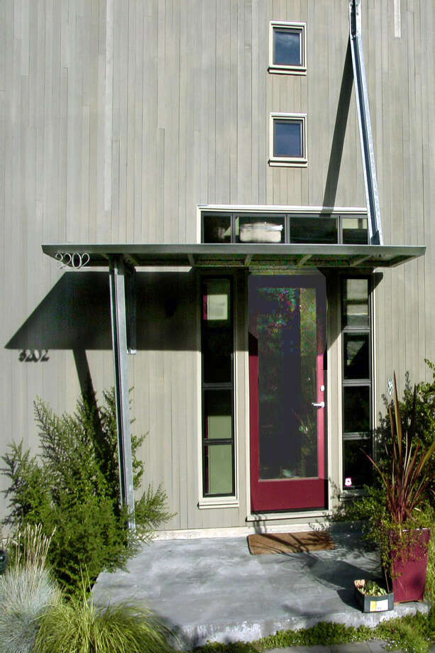 "The Atrium house, 3202 10th Ave. W., in Seattle, was built in 1950 by redesigned by Castanes Architects in 2000. ""Light, views and access to the outdoors are the main conceptual design determinants for this very urbane residence located on Queen Ann hill,"" according to a project writeup."" Photo: Castanes Architects"