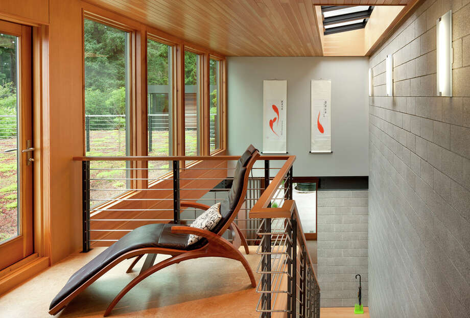 """The entire house is oriented to capture sun and shade and designed to passively heat and cool itself,"" according to a project writeup. ""The home also has a wide range of features to increase energy productivity including geothermal heat, photovoltaic energy collection, solar hot water, thermal massing and heat-recovery technologies. Additional key features include: two 1,500-gallon rainwater collection cisterns, radiant floor heating, site-milled wood trim, triple-glazed windows and a vegetated roof."" Photo: Lara Swimmer, Roger Turk, Northlight Photography / (c) Lara Swimmer ALL RIGHTS RESERVED"