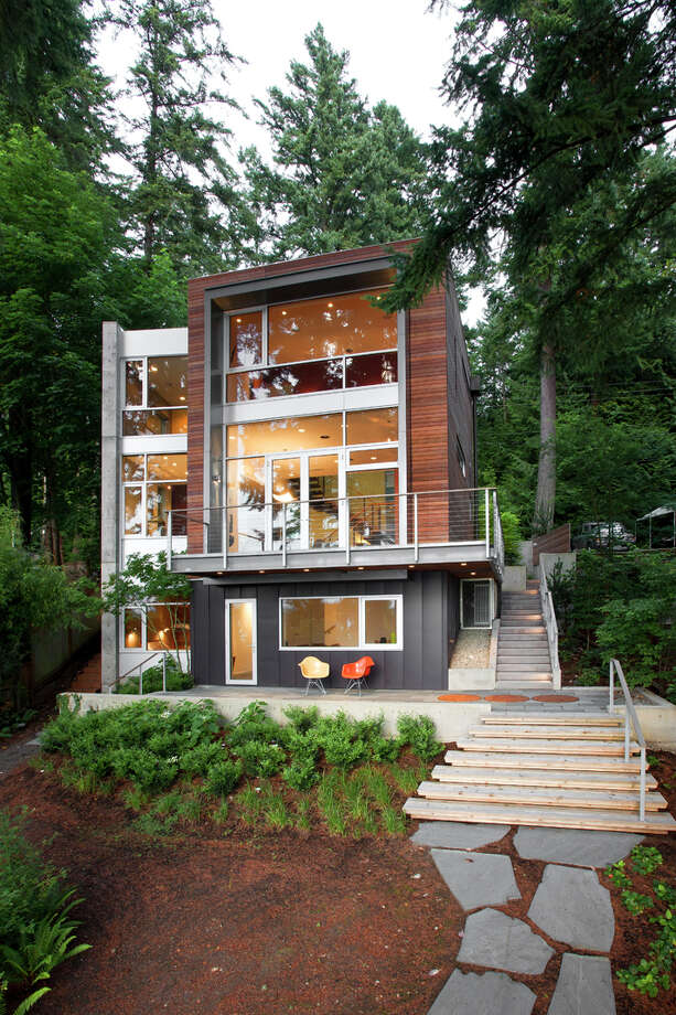"""Contemporary architecture fans can walk through eight area homes on Sept. 7 for $30, not counting gas and ferry fares.""""Thanks to a handful of generous homeowners, tour-goers get the chance to explore the inside and out of these awe-inspiring modern homes, designed by some of Seattle's greatest modern architects,"""" organizers of the self-guided Seattle Modern Home Tour wrote in a news release. """"Locations stretch from Bainbridge Island to Lake Sammamish and homes vary greatly in size, shape and design.""""Click on for a virtual tour, starting with the Dorsey Residence, designed by Coates Design Architects and built in 2010 at 8423 Hansen Road, on Bainbridge Island.""""With only a small buildable area available on the site, the home was designed to maximize the footprint through the use of vertical space which also takes advantage of the spectacular views of Puget Sound and Olympic Mountains to the west,"""" according to a project writeup.  Photo: Andrew Waits, Roger Turk,  Northlight Photography / © Andrew Waits"""
