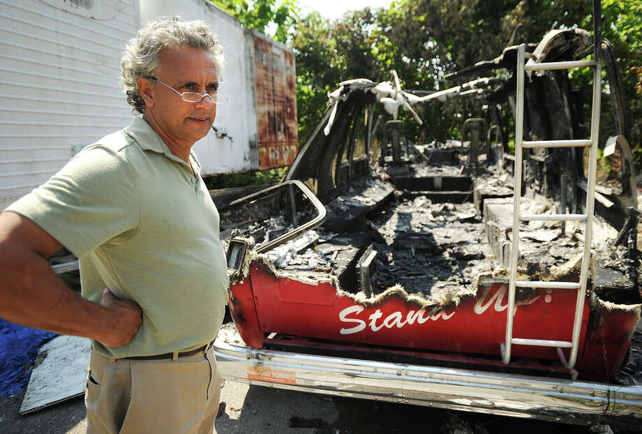 Republican candidate for Bridgeport City Council Rick Torres looks at the wreckage of his burned out campaign van on Wednesday, August 27 at the Raybestos site in Stratford, Conn. Photo: Brian A. Pounds / Connecticut Post