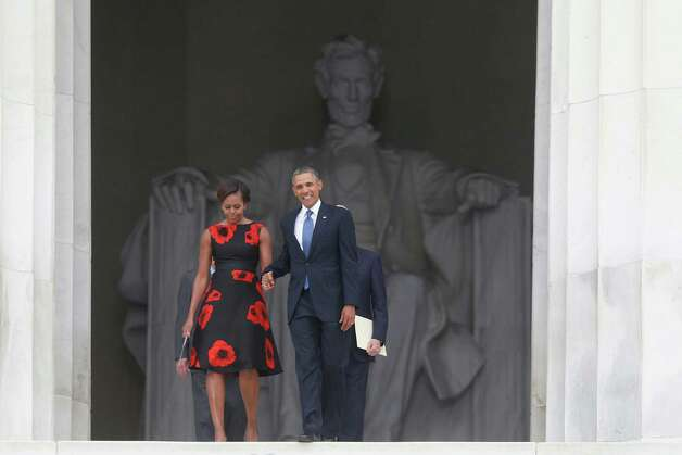 President Barack Obama and first lady Michelle Obama arrive at the 50th Anniversary of the March on Washington where Martin Luther King, Jr. spoke, Wednesday, Aug. 28, 2013, at the Lincoln Memorial in Washington. Photo: Charles Dharapak