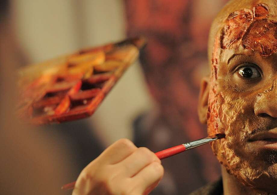 """A little blush will hide those acne pockmarks:A makeup artist works on a model during   Universal Studios' """"Halloween Horror Nights"""" kickoff at the Globe Theatre in Universal   City, Calif. Photo: Joe Klamar, AFP/Getty Images"""