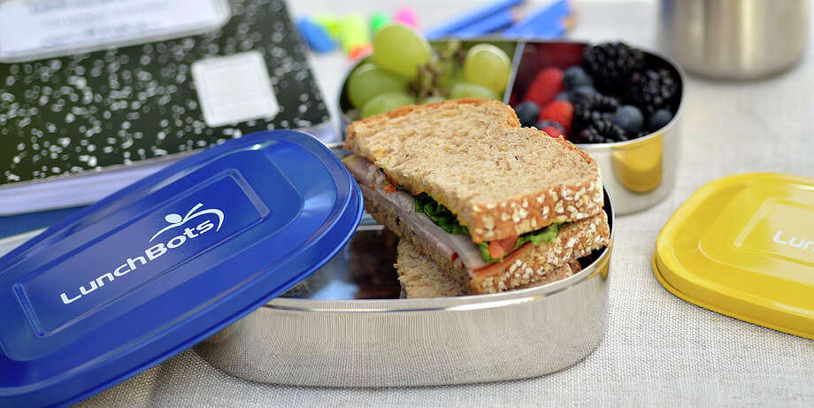 In this photo provided by LunchBots, multi-compartment divided containers make it easy to pack sandwiches and fruit as shown here. (AP Photo/LunchBots) ORG XMIT: MER2013082613394955 / LunchBots