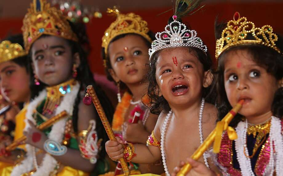 Why isn't mine gold?! One of several toddlers in tiaras wails at a perceived injustice during Janmashtami festival celebrations in Gauhati, India. The kids are dressed as the Hindu god Krishna for Janmashtami, which marks his birthday. Photo: Anupam Nath, Associated Press