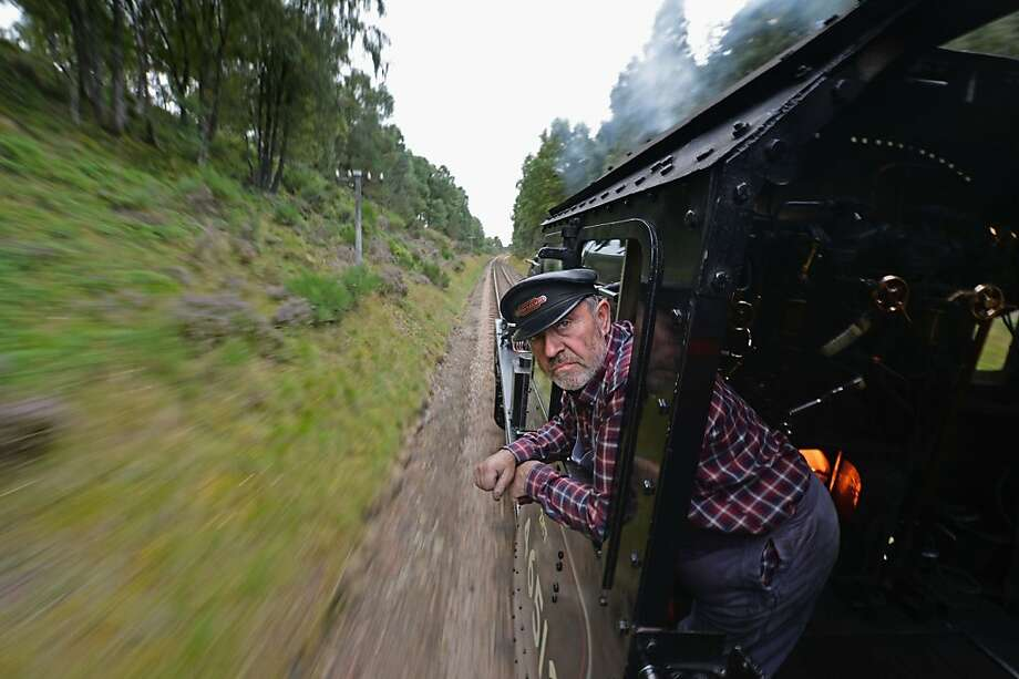 Engineer Scot: Henry Leese drives a 1952 British Rail Ivatt number 46512 locomotive on the Strathspey Steam Railway in Aviemore, Scotland. This year marks the 150th anniversary of the Highland Main Line linking the lairds of South Scottland with the landowners of the North. Photo: Jeff J Mitchell, Getty Images