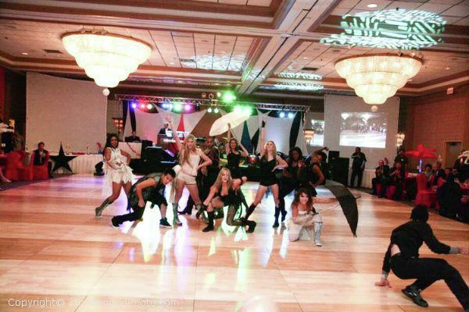 Fred Astaire Dance Studio is celebrating its third year in Cypress, where it holds dance events such as the Masquerade Ball. Photo: Photo Courtesy Of Fred Astaire Dance Studios