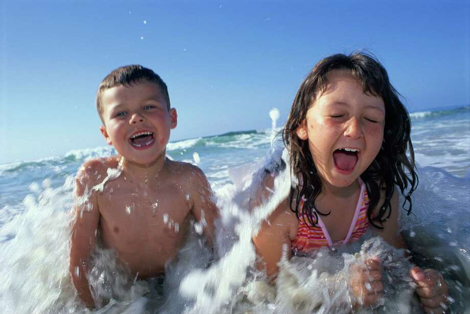 A trip to the Corpus Christi area wouldn't be complete without a trip to the beach to let the children splash around in the surf. Photo: Courtesy Photo