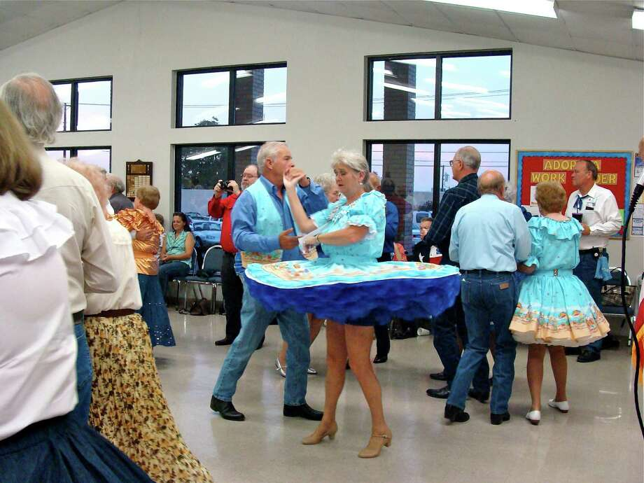 Longtime square dancing enthusiast Carolyn Smith and her husband, Preston, strut their stuff on the dance floor. Photo: Contributed