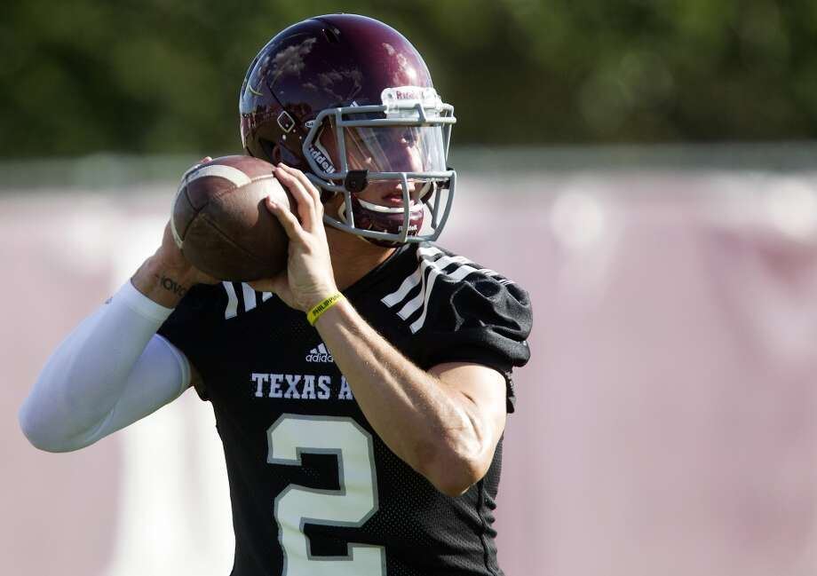 August 28, 2013: Manziel is suspended for half of the 2013 season opening game against Rice. Photo: Patric Schneider, Associated Press