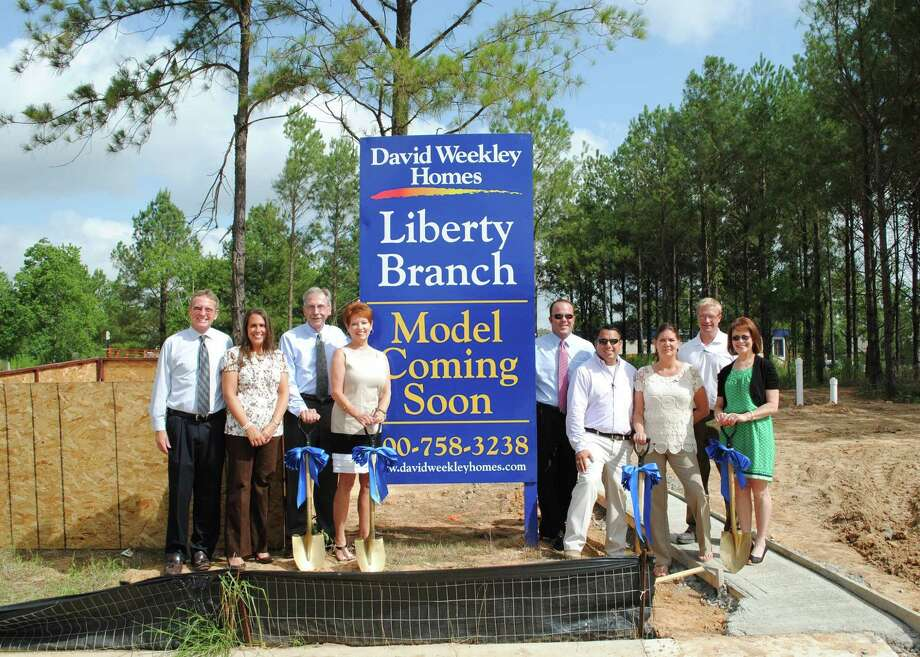 Participants in the groundbreaking ceremony for Liberty Branch at Creekside included: Mark Welch, from left, Jeanne Lewis, Tim Welbes, Barbara Reynders, Tracy Brown, Jeff Martinez, Suzi Bayer, Brandon Hopper and Susan Vreeland-Wendt. Photo: Courtesy Of David Weekley Homes