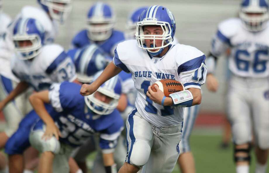 Freshman tailback Robby Waters looks for more daylight as he breaks for yardage at the annual Blue & White football game in Darien, June 16th, 2013. Photo: J. Gregory Raymond / Stamford Advocate Freelance;  © J. Gregory Raymond