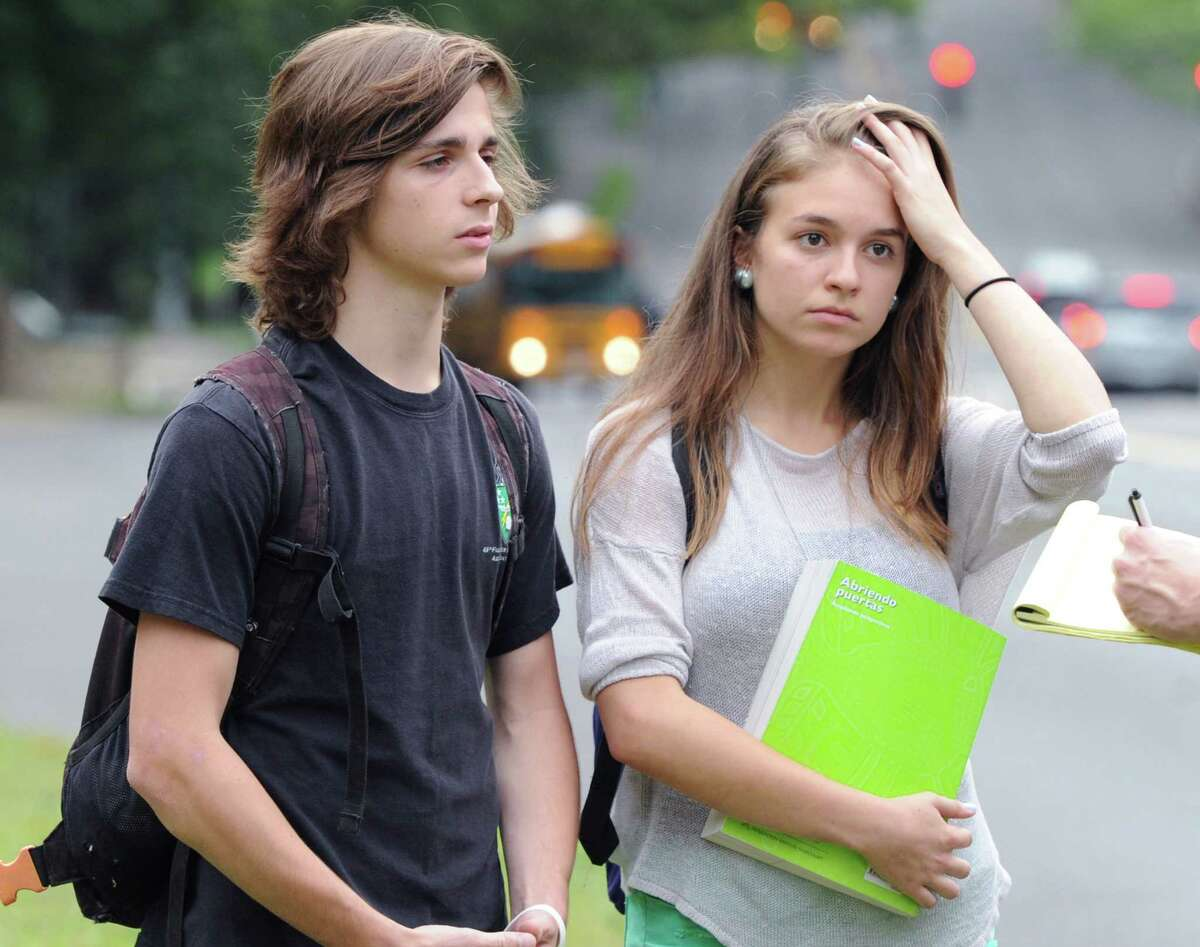 Greenwich High School seniors, Sean Thomalen, left, and Cristina de la Vega, speak with a Greenwich Time reporter regarding the suicide of a fellow student, after dismissal from school, Wednesday afternoon, August 28, 2013. A Greenwich High School sophomore, widely reported to have been the victim of bullying, committed suicide after the first day of classes Tuesday. Bartlomiej